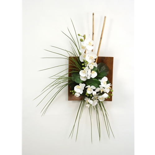 wall hanging with silk orchids bamboo and grass in a wood