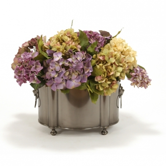 Lavender and Cream Mix of Silk Hydrangeas and Lilacs with Salal in a Black Pewter Oval Planter