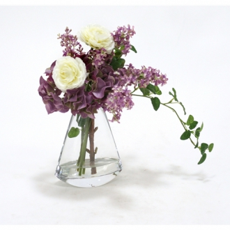 Waterlook ® Lavender Lilacs and Hydrangeas with Cream White Ranunculus in Glass Rocker Vase