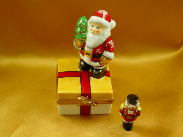 Santa on present with removable nutcracker