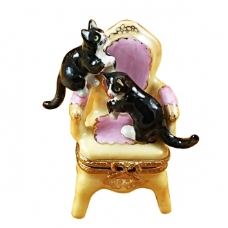 Pink armchair w/two cats
