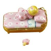 BABY IN PINK BED WITH PACIFIER
