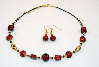 Cubes, oblongs and globes red murano glass necklace and earrings set