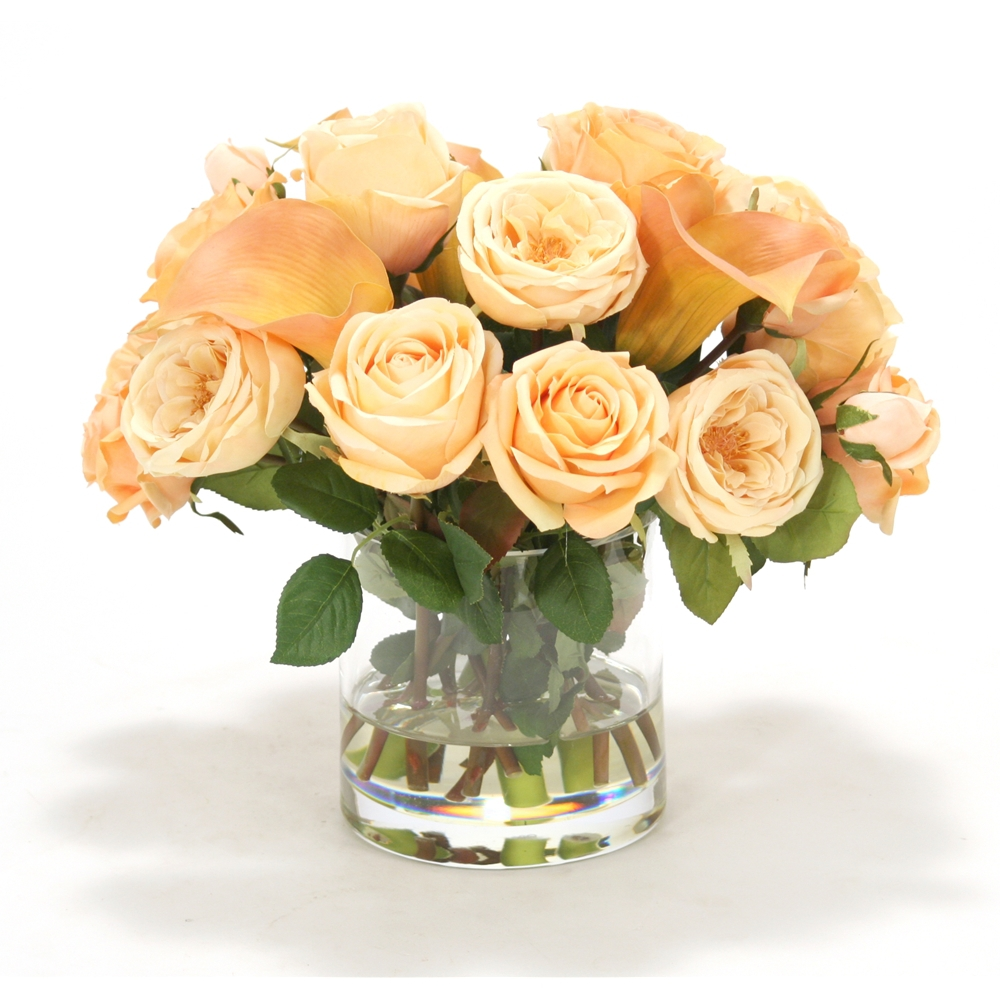 Cream peach and champagne yellow mixed roses with Rose cream Calla lilies in round cylinder