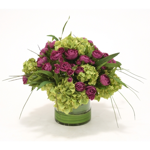 Waterlook ® Purple Ranunculus with Green Hydrangeas in Clear Cylinder Vase