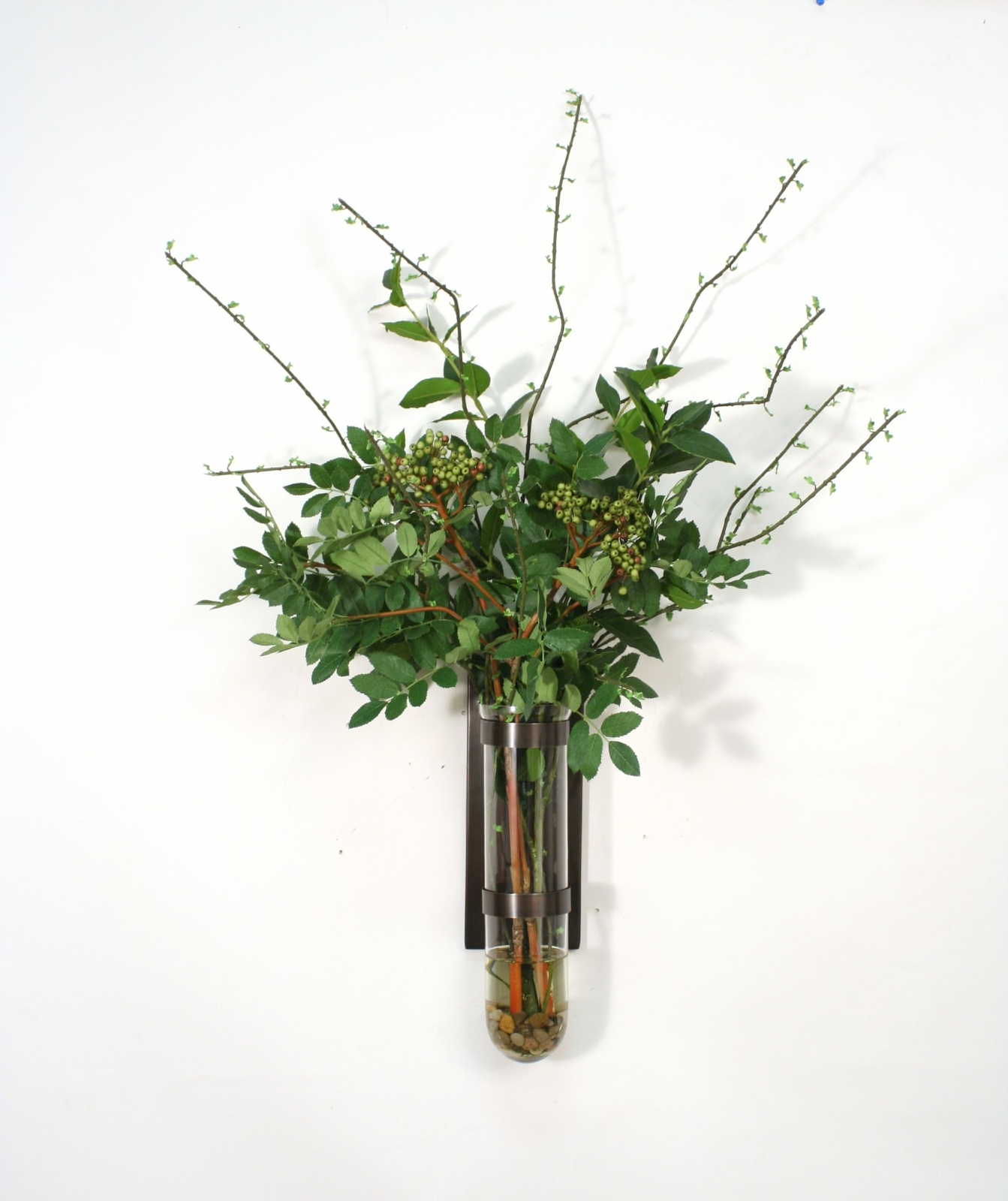 Waterlook® Mixed Greenery and Berries in Large Test Tube with Bronze Wall Base