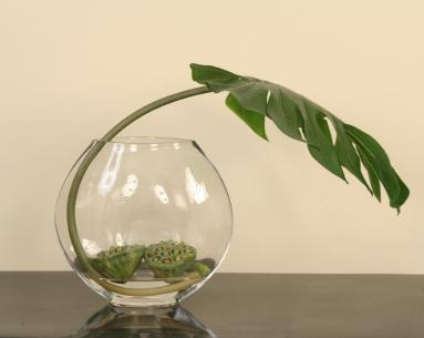 Artistic Waterlook ® Design Featuring Silk Philo Leaf with Lotus Pods in a Glass Disk