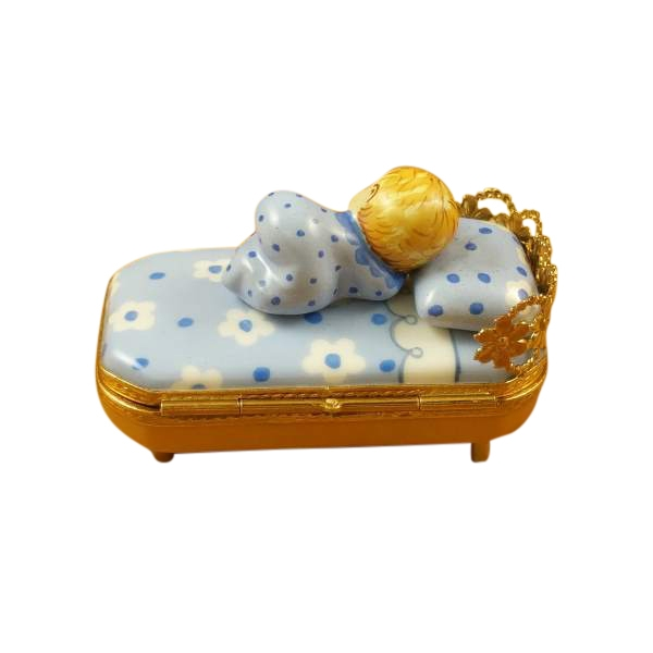 Baby in Blue Bed With Pacifier