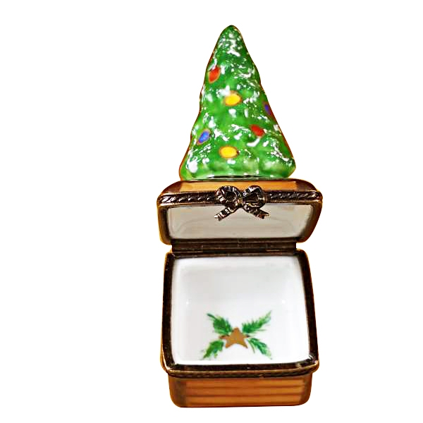 SMALL CHRISTMAS TREE ON BROWN BASE