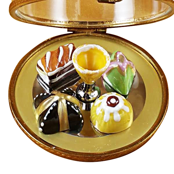 Domed dessert tray with pastries and champagne