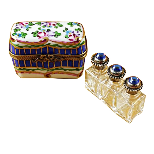 BLUE AND FLORAL CHEST WITH THREE BOTTLES