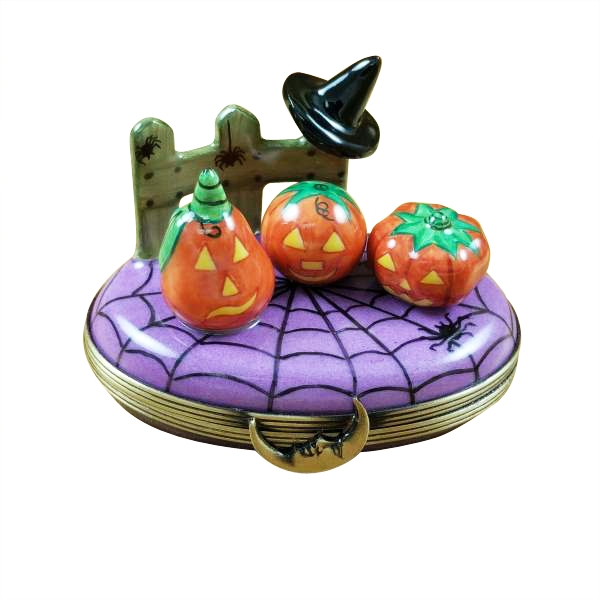 3 pumpkin scene with witch hat on fence