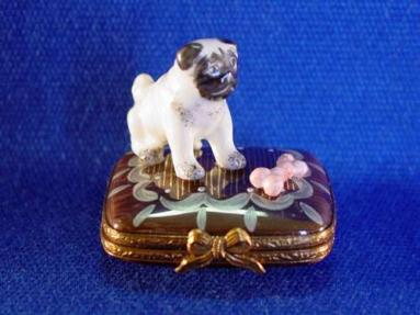 PUG ON BASE WITH BONE