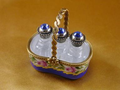 Basket with three perfume bottles