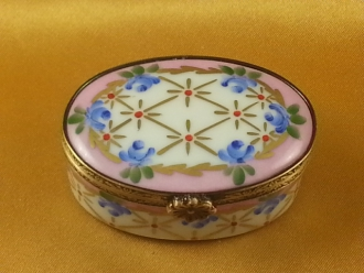 PINK OVAL WITH BLUE FLOWERS