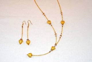 Gold murano glass dangle heart necklace and earrings