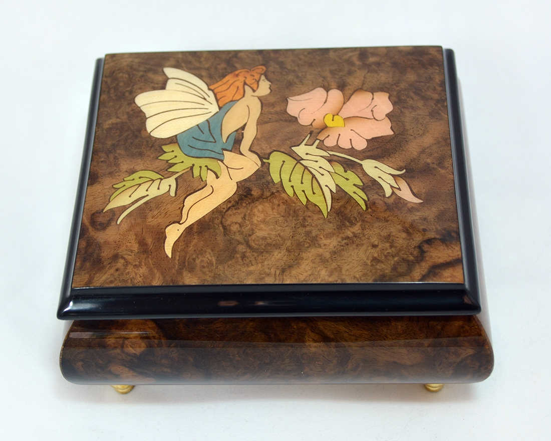 Fairy on flower burl music box